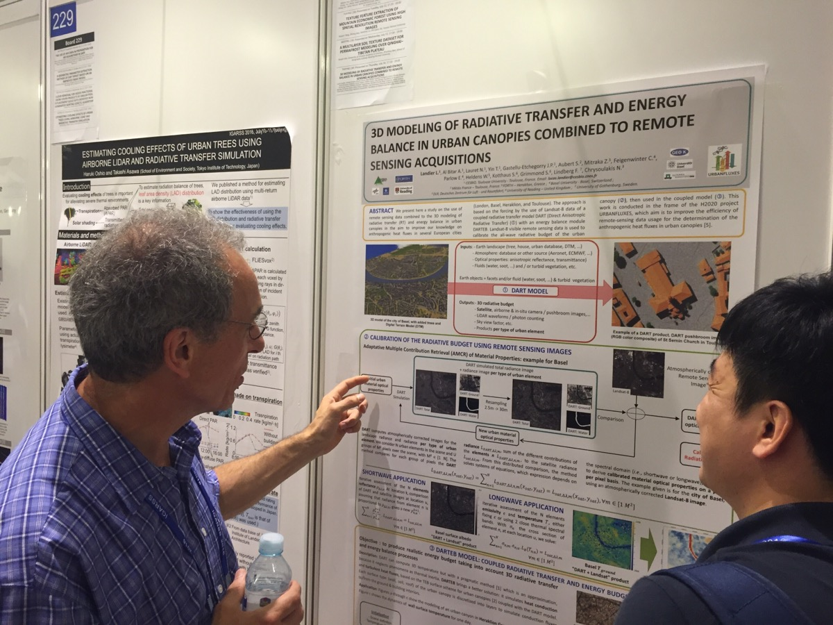 Jean-Philippe Gastellu-Etchegorry discussing the DART model poster during IGARSS 2016 poster session