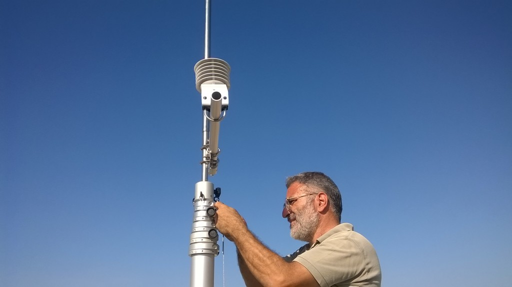 Nektarios Spyridakis mounting the IRGASON on top of the telescopic mast